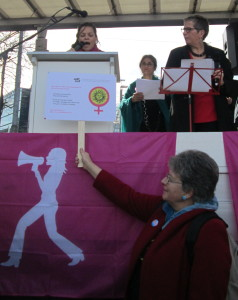 """ADF-SVF suisse addressing the audience: Charlotte Mosquera reading the statement and Martine Gagnebin, president of ADF-SVF suisse, holding up our logo"""